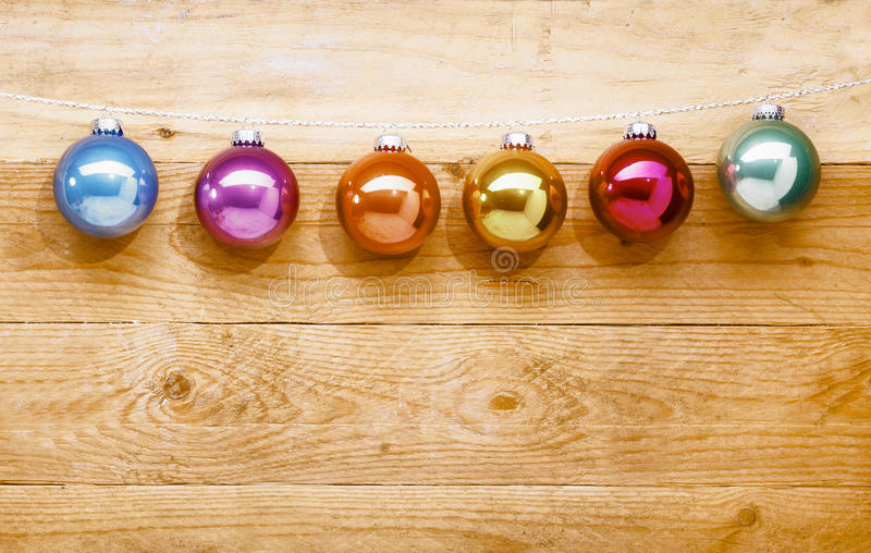 String of colourful Christmas baubles royalty free stock photo