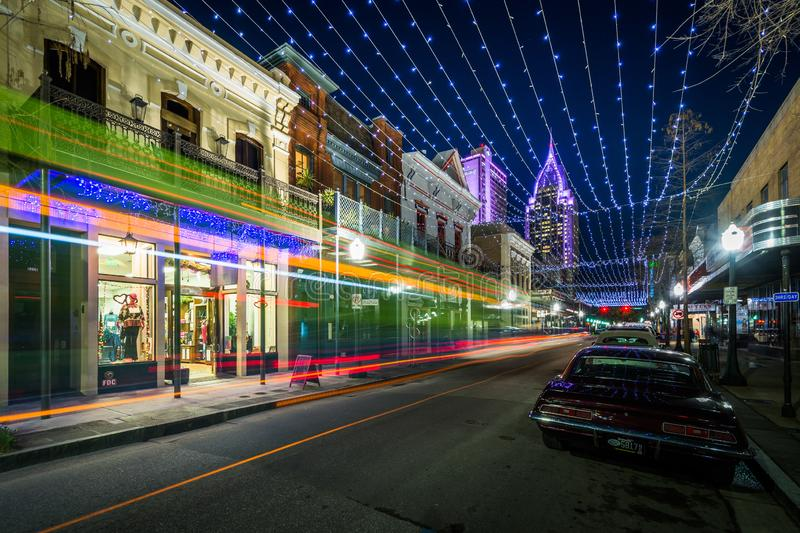 String lights hung over Dauphin Street, and buildings in downtown Mobile, Alabama.  royalty free stock photo