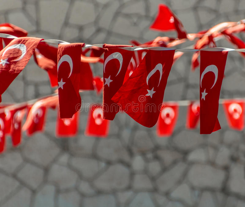 String of Turkish Flags. In a small resort city of Alaçatı, Turkey streets of Old Town are decorated with festive strings of Turkish Flags royalty free stock photography