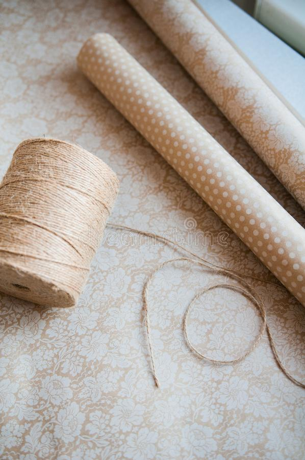 String or twine tied in a bow on kraft paper background royalty free stock photo