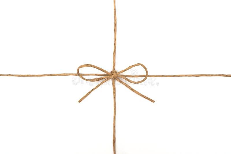 Stringa legata in un arco su bianco fotografie stock libere da diritti