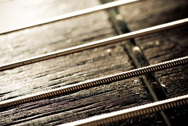 Stringhe della chitarra immagine stock libera da diritti