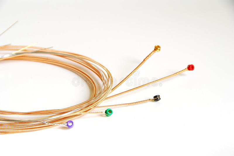 Stringhe della chitarra acustica fotografie stock