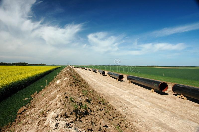 Pipeline scenery. Stringing pipes during the construction of a pipeline on the project Arc de Dierrey in France royalty free stock image
