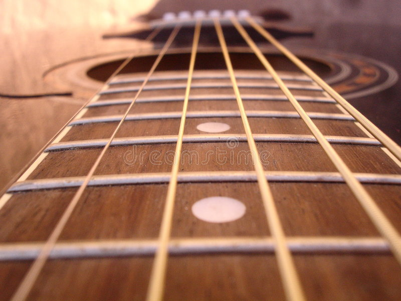 Strings. Close up of an acoustic guitar stock photos