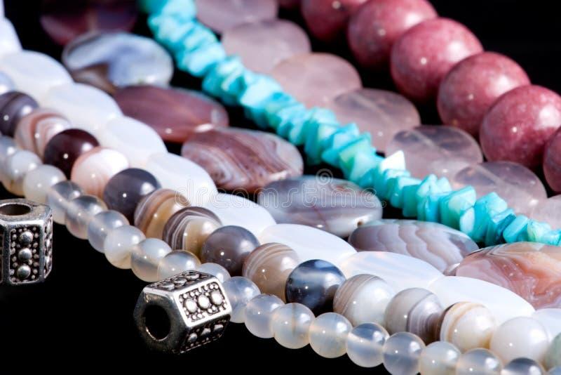 Strings of gem stones beds