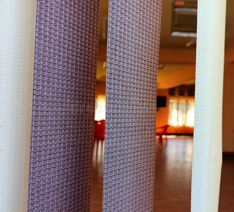 Strip curtains in a luxury hotel room window view stock image