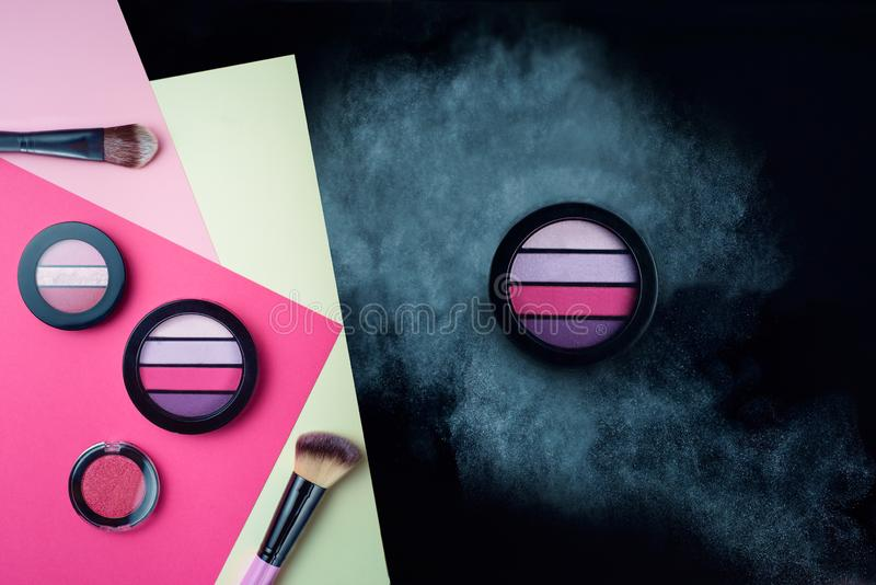 Strip eyeshadow on a cloud of bright dust stock image