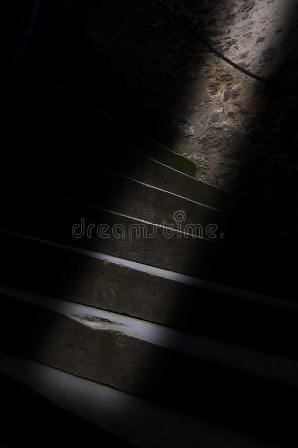 The strip of light on the old staircase royalty free stock photography