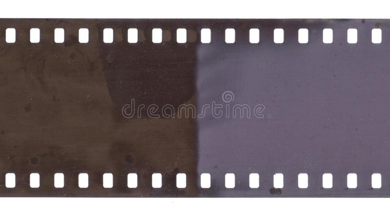 Strip of old film with dust and scratches isolated. On white royalty free stock image