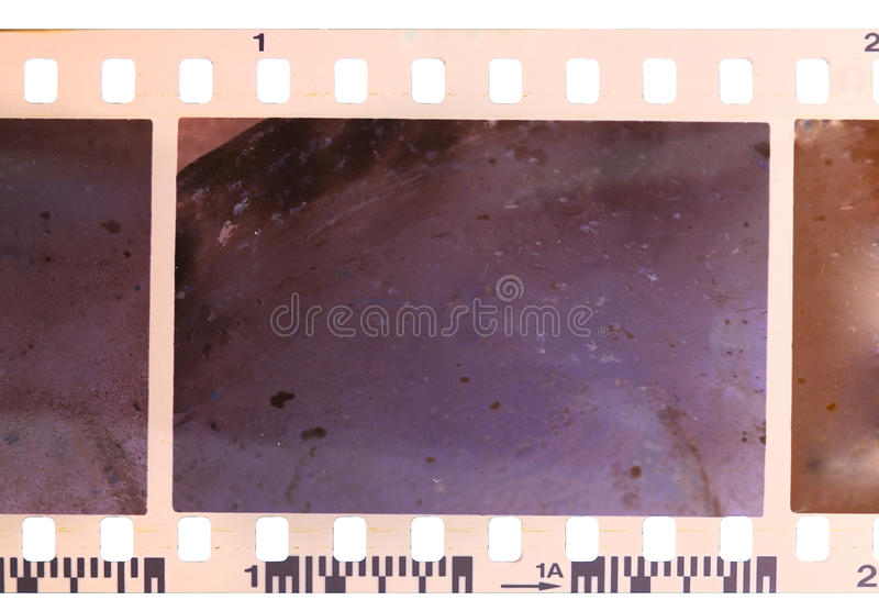 Strip of old, worn and bad developed color celluloid film. Isolated on white background stock photo