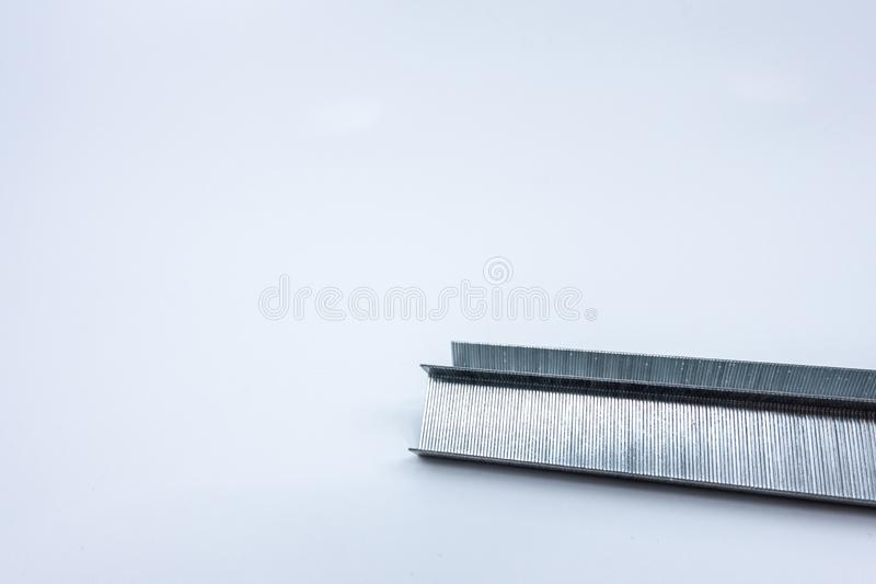 Strip of staples isolated against a white background. Office supplies - image royalty free stock photography