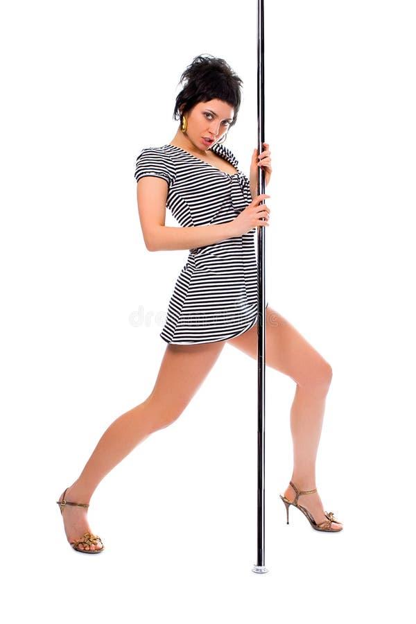 Strip-tease di dancing della ragazza del brunette di bellezza fotografie stock libere da diritti
