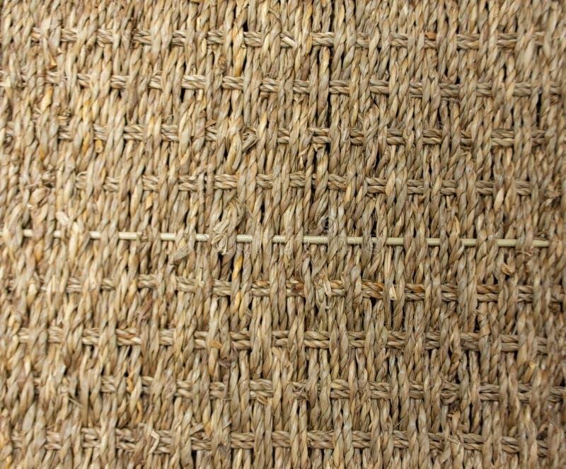 Striped заплел веревочку используемую как предпосылка стоковое фото rf
