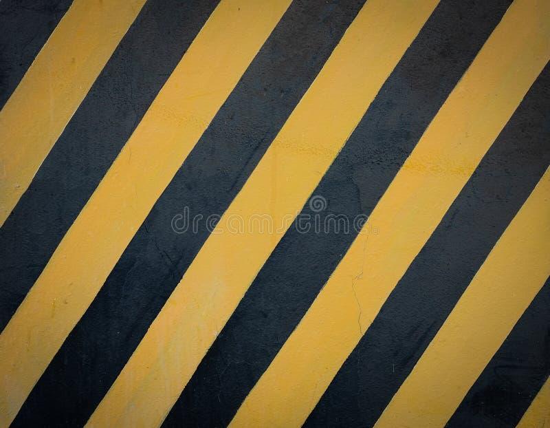 Striped черная и желтая предпосылка grunge стоковое фото