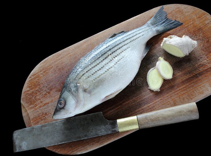 Striped bass and ginger stock image