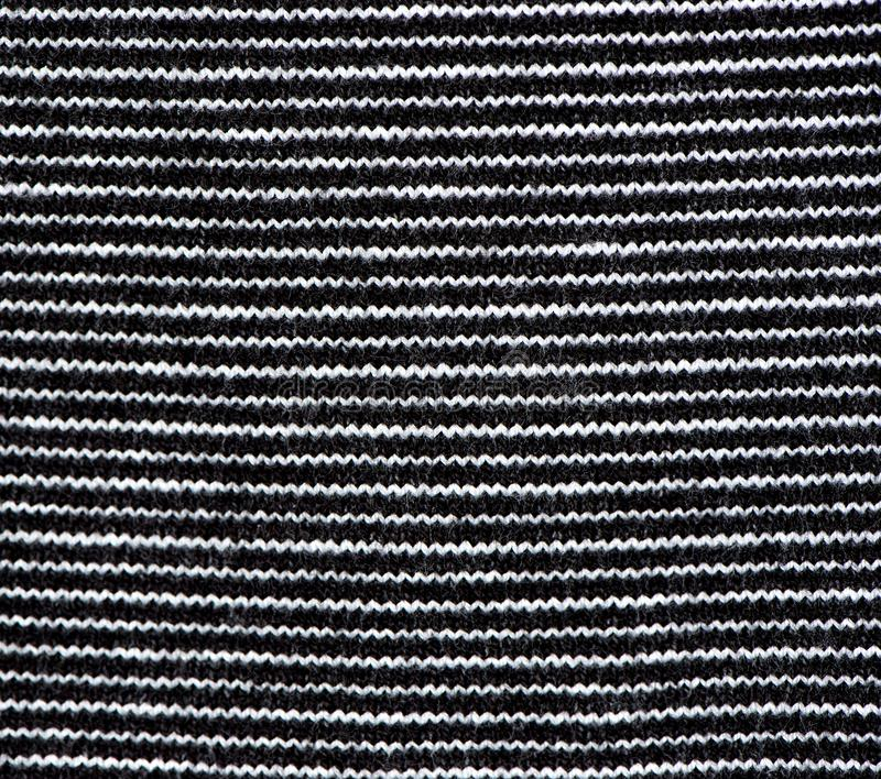 Striped black and white knit fabric texture, knitted pattern ba. Knitting. Horizontal striped black and white knit fabric texture, knitted pattern background royalty free stock photography