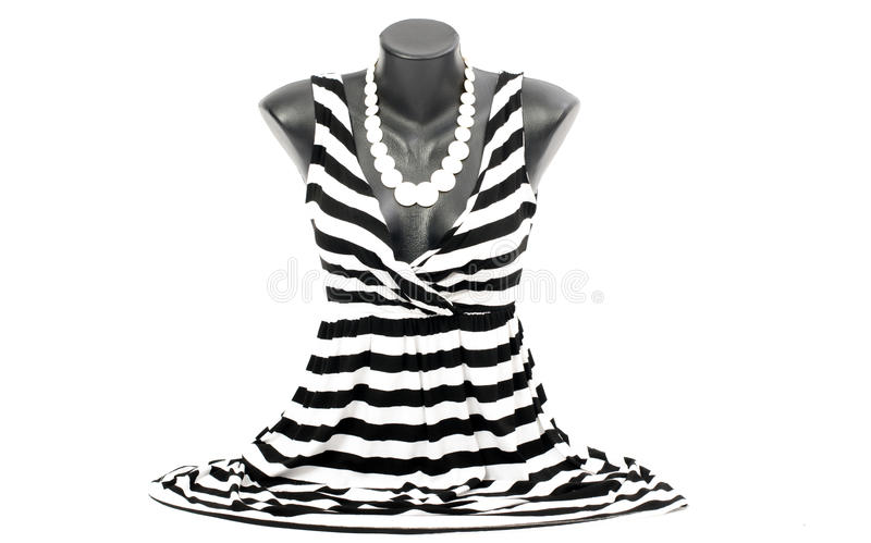 Striped blouse on mannequin with matching accessories. royalty free stock image