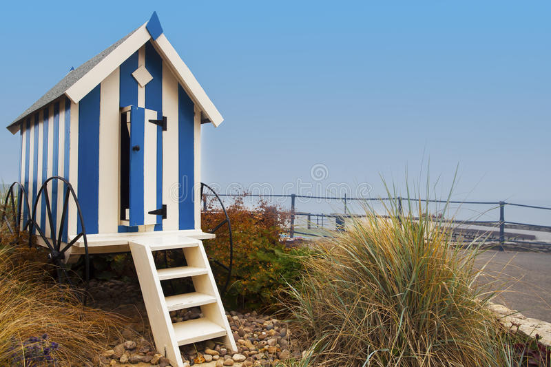 Striped blue beach hut on Filey promenade stock image