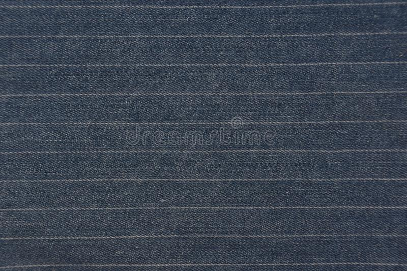 Blue denim jeans with stripes texture background. Striped blue denim jeans texture / pattern background. Close up from pants stock photography