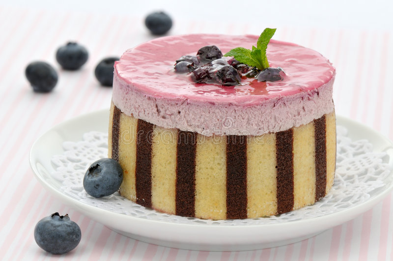 Striped blueberry mousse cake stock photos