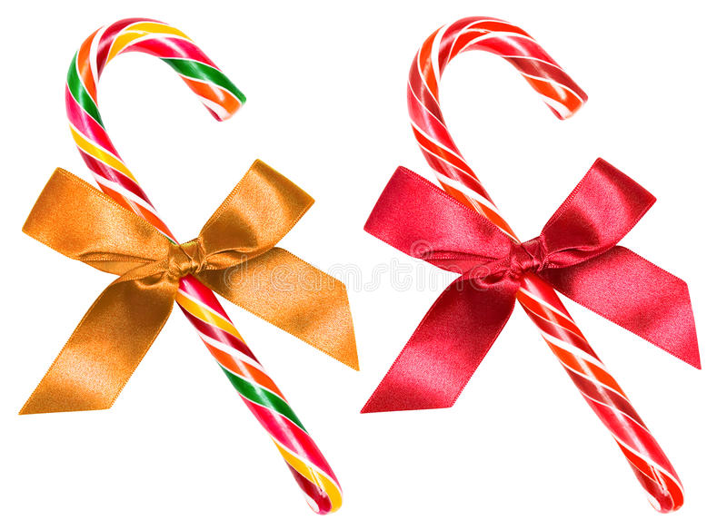 Striped candy cane with bow isolated over white, clipping path. Striped Christmas candy cane red and multicolor with bow, isolated over white, clipping path royalty free stock image