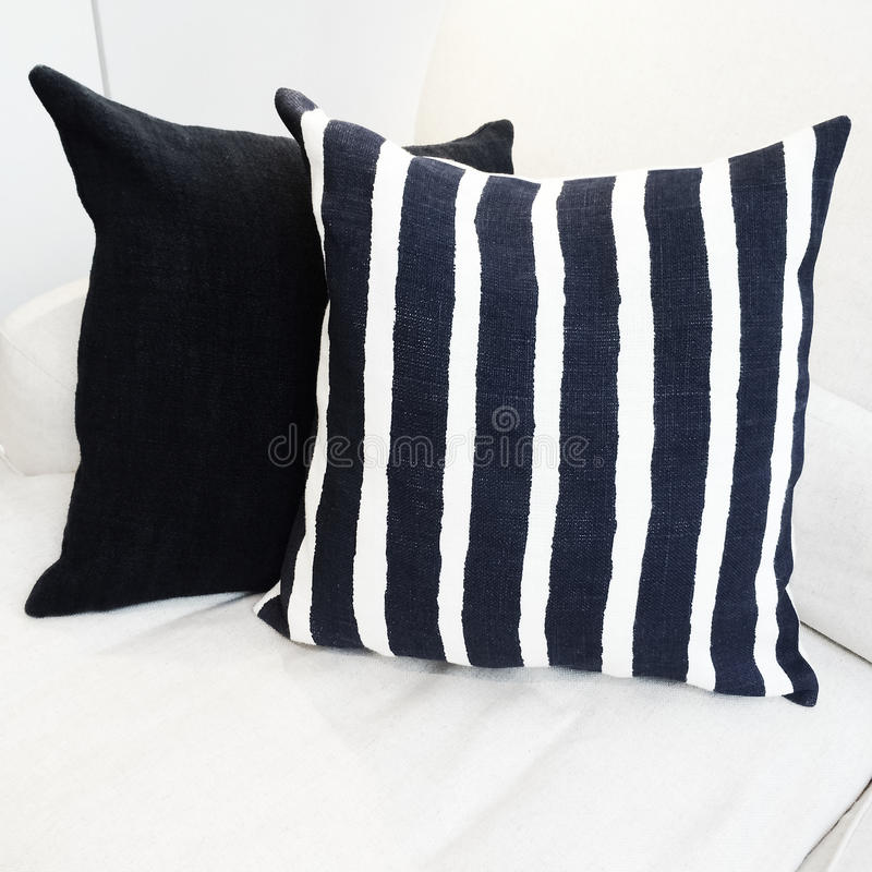 Striped cushion on a sofa royalty free stock images