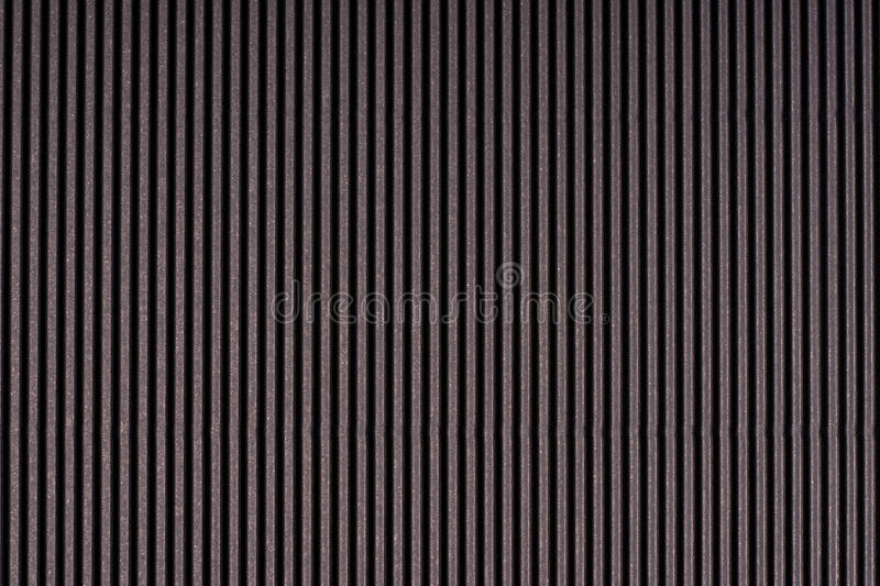 Striped dark gray embossed paper. Colored paper. Black texture background.  royalty free stock photography