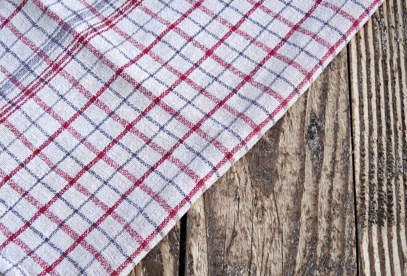 Striped dish cloth on brown wood