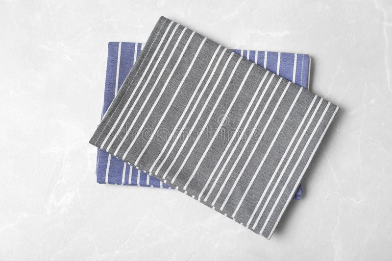 Striped fabric table napkins on light background. Top view royalty free stock image