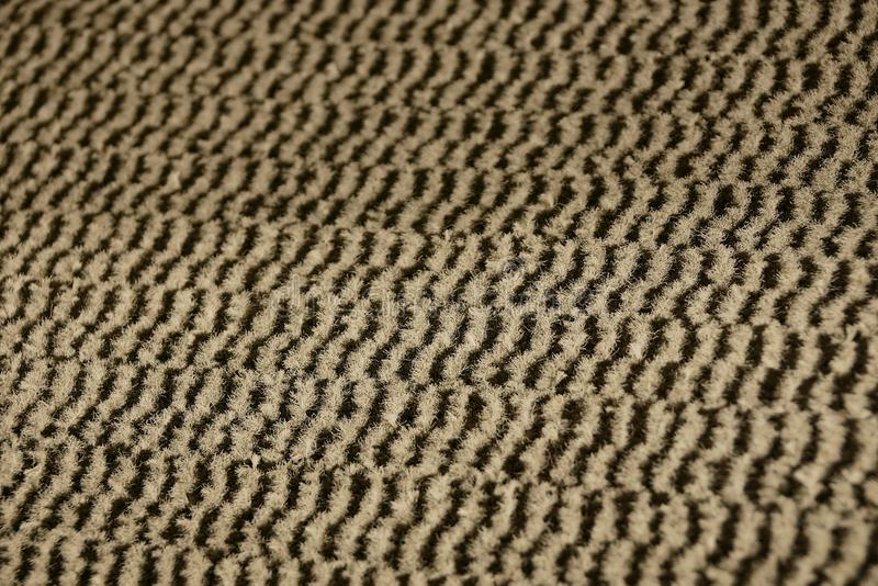 Striped fabric texture from a piece of woolen carpet royalty free stock image