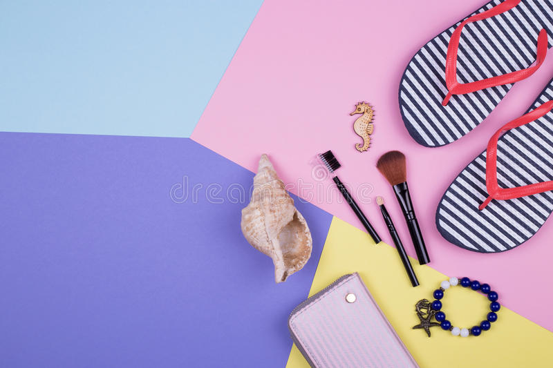 Striped flip flops on a colorful background stock photos