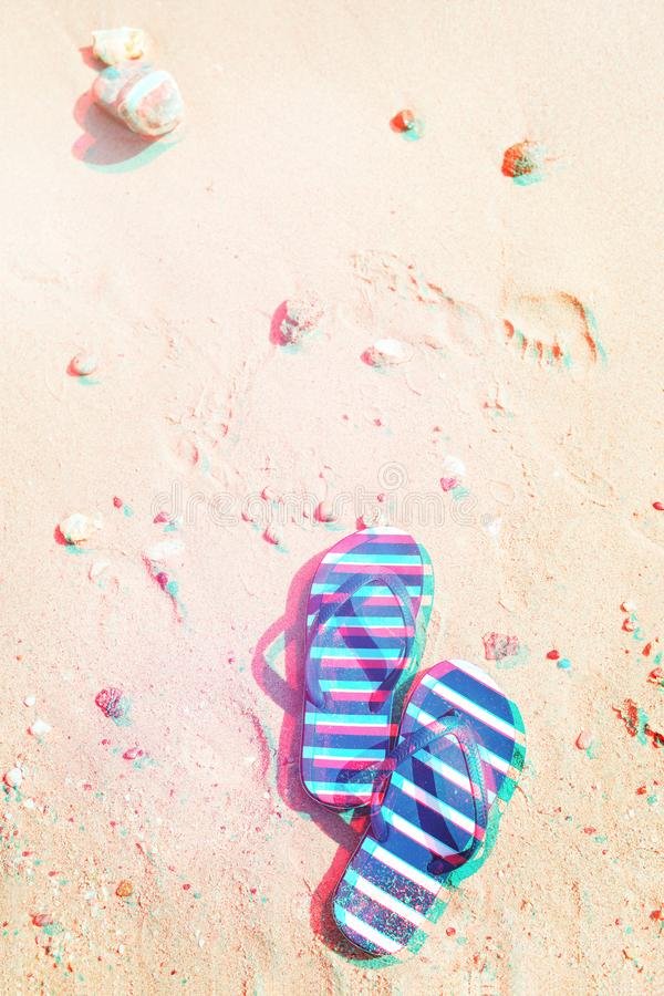 Striped flip flops on the sand. stock image