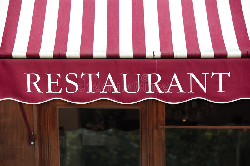 Striped french restaurant entrance canopy, Paris france. royalty free stock photos