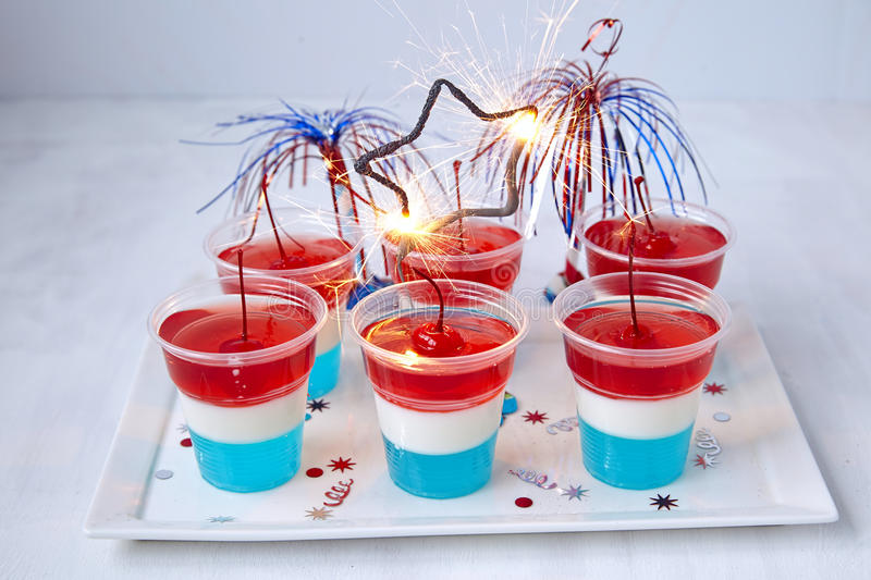 Striped jelly shots with firecracker star. Striped firecracker jello shots for 4th july royalty free stock photos