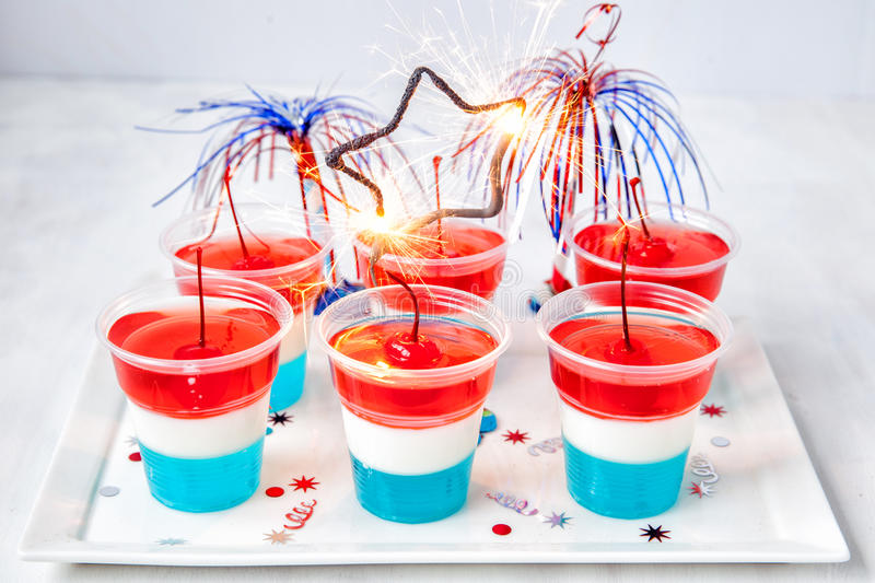Striped jelly shots with firecracker star. Striped firecracker jello shots for 4th july stock photography