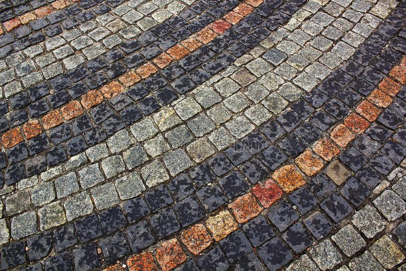 Striped paving cobbles stones mosaic pattern. Background stock photos