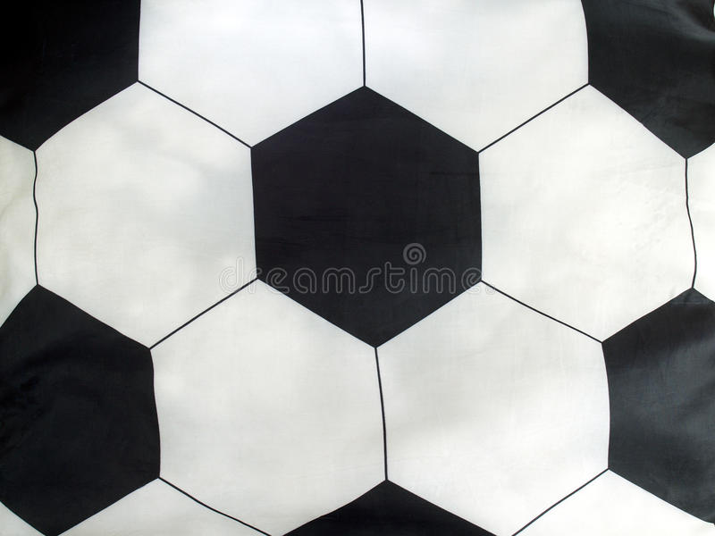 close-up striped pillow soccer ball, bedding sport style stock images