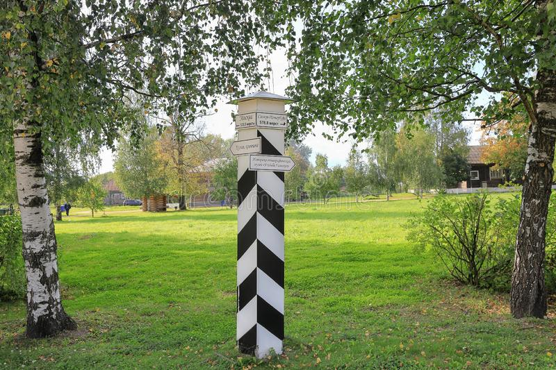 Striped pole with direction signs in the estate Galsky.  Vologda region, Cherepovets city,  September 7, 2019 royalty free stock photos