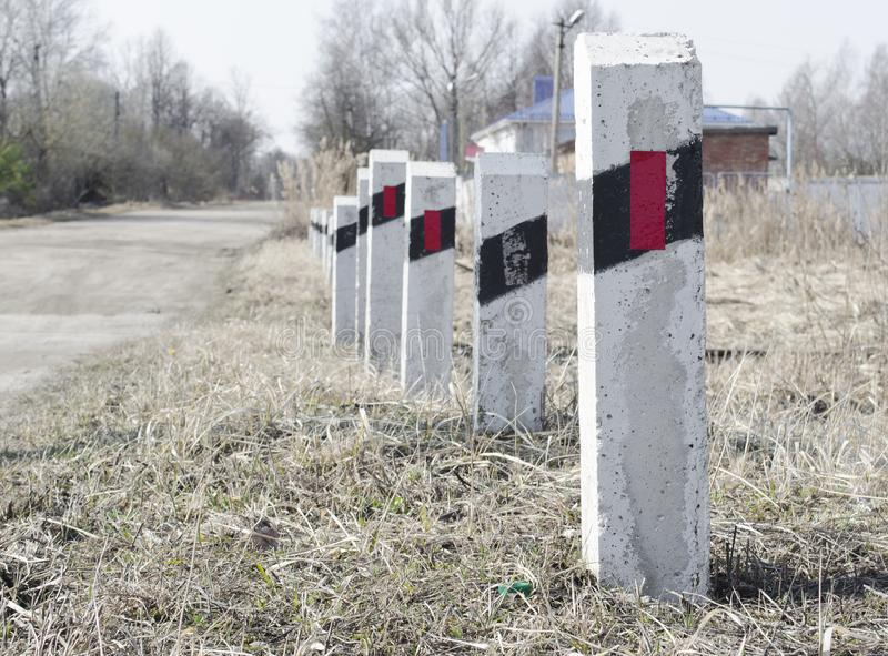 Striped poles near the railway crossing. Speed Limit. Security. A warning stock photo