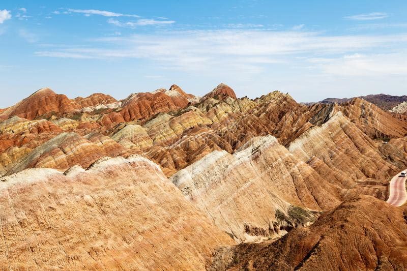 Striped rock formations in Danxia Feng, or Colored Rainbow Mountains, in Zhangye, Gansu. China. Here the view from the Sea of Clouds observation deck stock images