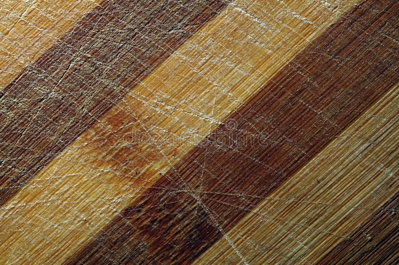 Striped scratched wood. Wooden surface with double color stripes and scratches royalty free stock photo