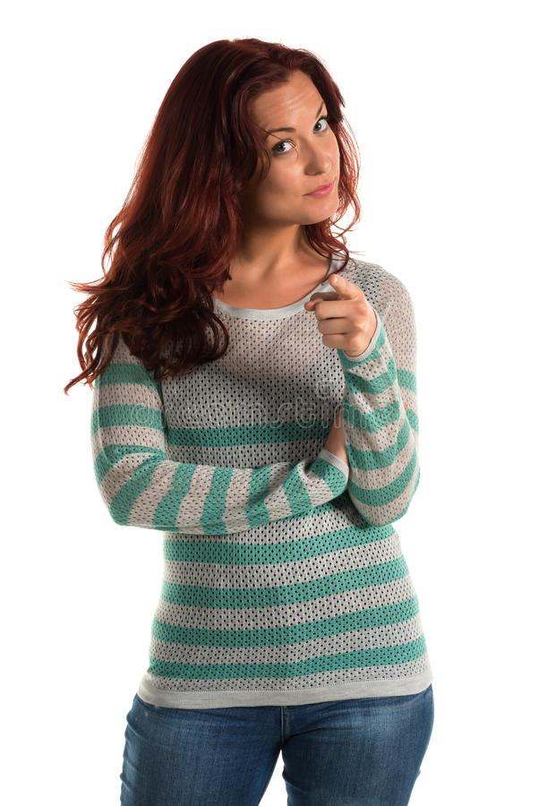 Striped sweater. Pretty redheaded woman in a striped sweater stock photography