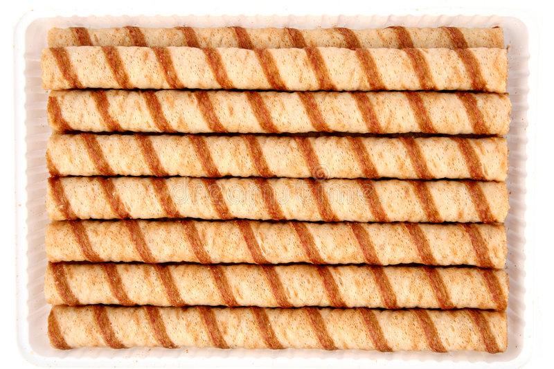 Striped wafer tubules with a chocolate cream stock images