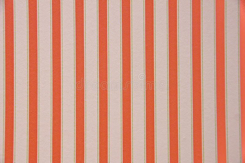 Striped wallpaper. A vertically striped wallpaper in red and white royalty free stock photos