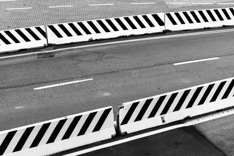 Striped white concrete border blocks royalty free stock images