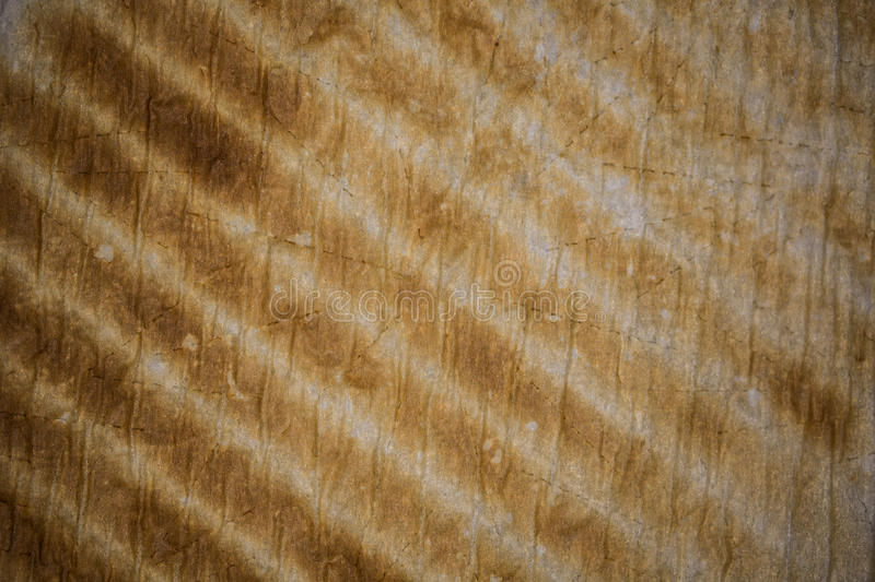Stripes. Used baking paper texture with brown diagonal stripes royalty free stock image
