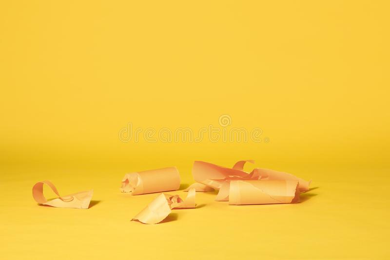 Stripes of Yellow Paper on Vibrant Yellow Seamless Background stock photo