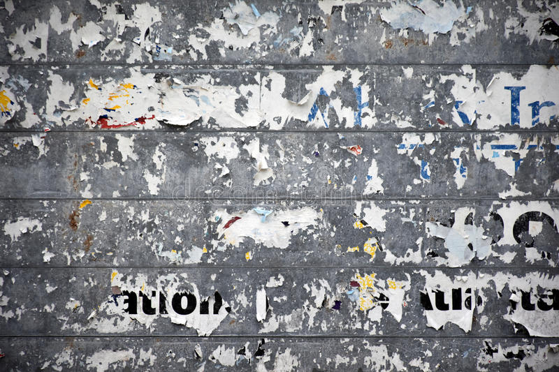 Stripped Roadside Billboard. A section of a stripped poster remains from a roadside billboard royalty free stock images
