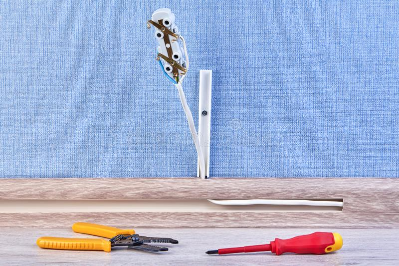 Stripped wire and screwdriver, closeup royalty free stock images